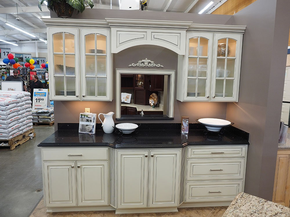white kitchen cabinets with glass panes display in thomas home center showroom
