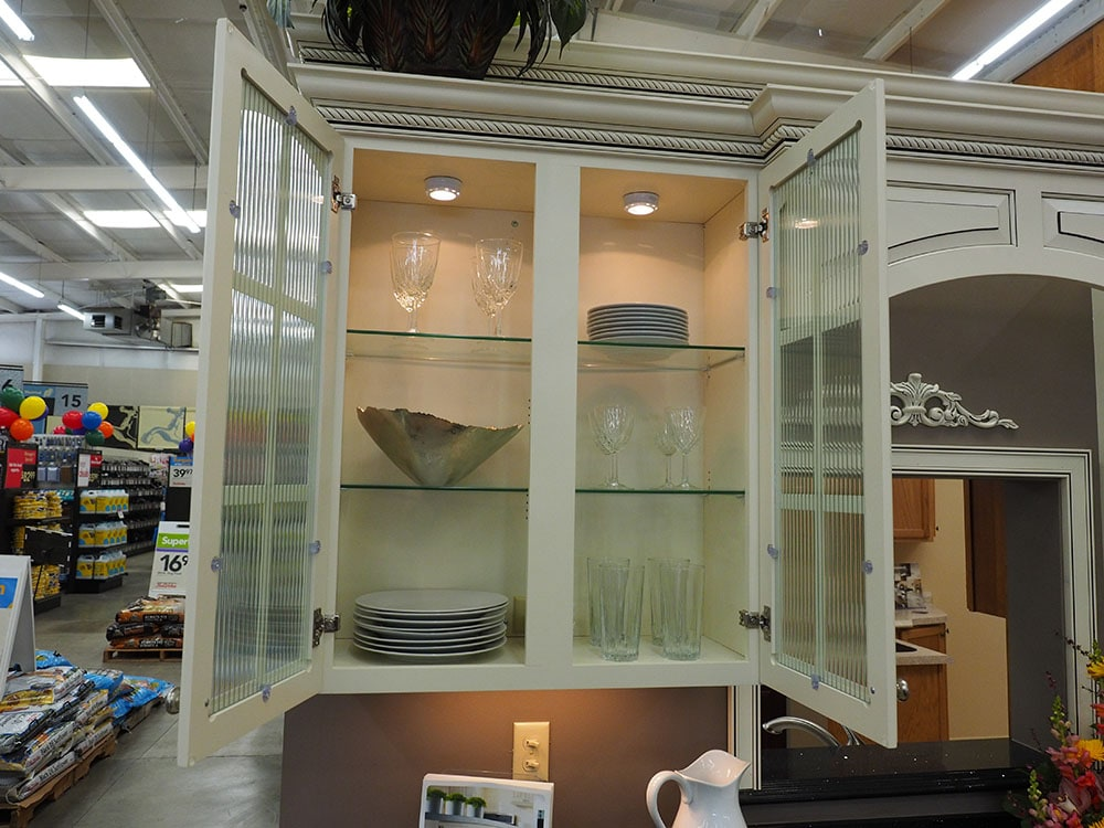 white kitchen cupboard with glass panes in thomas home center showroom